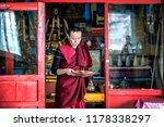 Small photo of IVOLGINSKY DATSAN, ULAN UDE, SIBERIA, RUSSIA - MARCH 24, 2018: Buryat buddhist monks are in ceremony at the Dzogchen Dugan in Ivolginsky datsan