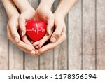 man and woman holding red heart ... | Shutterstock . vector #1178356594