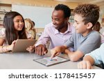 teacher helping school kids... | Shutterstock . vector #1178415457