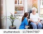 senior woman sitting in... | Shutterstock . vector #1178447587