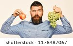 man with beard holds bunch of... | Shutterstock . vector #1178487067