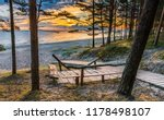 wooden footpath leading to a... | Shutterstock . vector #1178498107