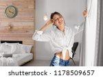 young happy woman near window... | Shutterstock . vector #1178509657