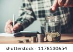 business man putting coin in... | Shutterstock . vector #1178530654