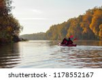 Two Girls In A Red Kayak Paddle ...