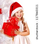 Child In Santa Hat With Gift...