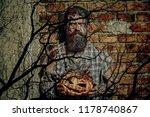 halloween man with pumpkin on... | Shutterstock . vector #1178740867