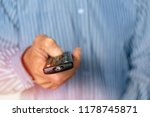 the man is holding the tv... | Shutterstock . vector #1178745871