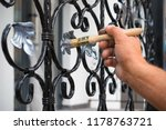 contractor's hand with brush... | Shutterstock . vector #1178763721