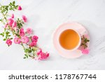 cup of tea and branch of small...   Shutterstock . vector #1178767744