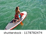 young woman paddleboarder | Shutterstock . vector #1178782474