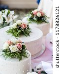 White Wedding Cake Tiers With...