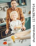 spacious kitchen. bearded...   Shutterstock . vector #1178879914