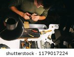 a young male jeweler in his... | Shutterstock . vector #1179017224