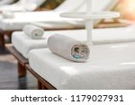 sunbeds with towels near the... | Shutterstock . vector #1179027931