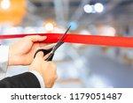 businessman cutting red ribbon... | Shutterstock . vector #1179051487