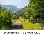 a glade among the mountains... | Shutterstock . vector #1179057217