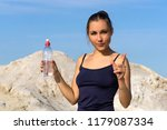 young slender athletic girl... | Shutterstock . vector #1179087334
