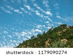 mountain ridge against cloudy... | Shutterstock . vector #1179090274