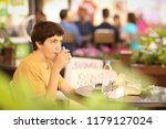 teenager boy on lunch break sit ... | Shutterstock . vector #1179127024