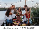 group of young people having... | Shutterstock . vector #1179149341