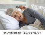 Old Woman Sleeping On Bed At...