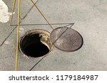open hatch in the asphalt with... | Shutterstock . vector #1179184987