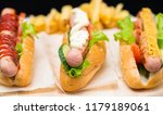 three assorted hot dogs with... | Shutterstock . vector #1179189061