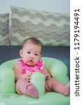 innocent little baby is sitting ... | Shutterstock . vector #1179194491