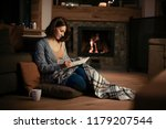 beautiful woman sitting by the... | Shutterstock . vector #1179207544