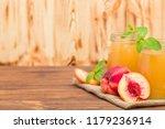 peach smoothie in glass jars... | Shutterstock . vector #1179236914