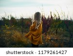 woman in an autumn field with... | Shutterstock . vector #1179261427