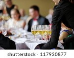 waitress with dish of champagne ... | Shutterstock . vector #117930877