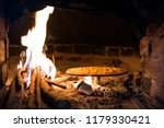 italian pizza is cooked in a... | Shutterstock . vector #1179330421