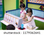 asian chinese little sisters... | Shutterstock . vector #1179362641
