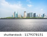 empty asphalt road with city... | Shutterstock . vector #1179378151