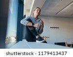 woman relaxing after workout... | Shutterstock . vector #1179413437