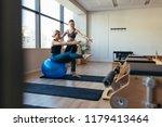 female pilates instructor... | Shutterstock . vector #1179413464
