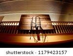 old basketball hoop hanging in... | Shutterstock . vector #1179423157