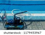 cleaning the sports pool with a ... | Shutterstock . vector #1179453967