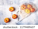 fresh apples in a mesh bag  top ... | Shutterstock . vector #1179489637