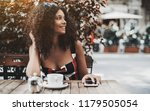 a young cute curly woman is... | Shutterstock . vector #1179505054