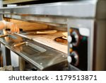 baking in the oven | Shutterstock . vector #1179513871