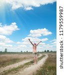 girl enjoys the sun standing on ...   Shutterstock . vector #1179559987