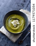 thick  creamy green soup topped ... | Shutterstock . vector #1179571054