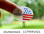 i voted sticker on a woman s... | Shutterstock . vector #1179591421