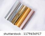 metallic colored vinyl rolls | Shutterstock . vector #1179656917