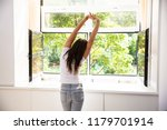 woman stretching her arms in... | Shutterstock . vector #1179701914