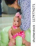 innocent little baby is sitting ... | Shutterstock . vector #1179774271