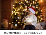 cute little boy wearing santa... | Shutterstock . vector #1179837124